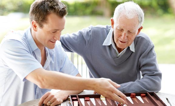 Caregiver playing game with senior